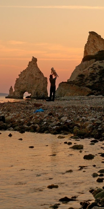 Greece, Cyclades. Kimolos. Faily affection in Mavrospilea beach. Sunset between the white rocks. © Maro Kouri