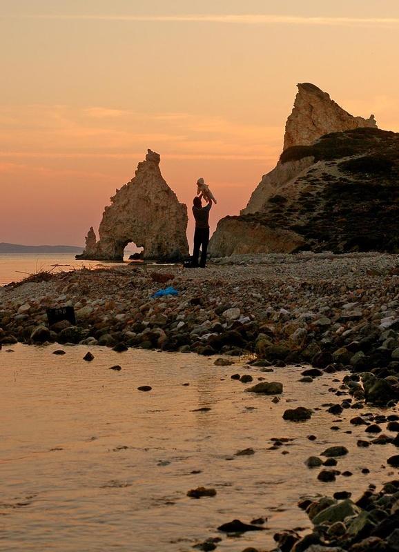 Greece, Cyclades. Kimolos. Faily affection in Mavrospilea beach. Sunset between the white rocks. © Maro Kouri