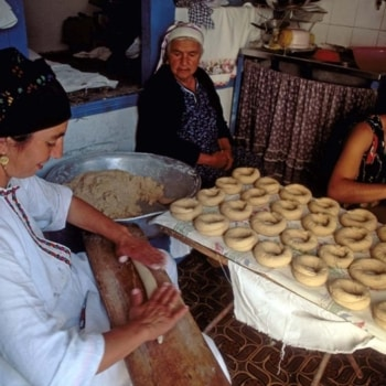 Karpathos, Olymbos: Untouched by Time Women prepare the bread dough to be baked in the traditional oven